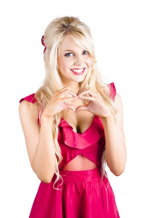 A blonde woman making a heart shape with her hands photo