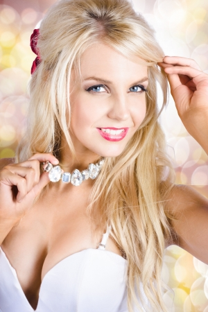 Breathtaking blond woman in classic fashion style and graceful makeup wearing necklace jewelry photo