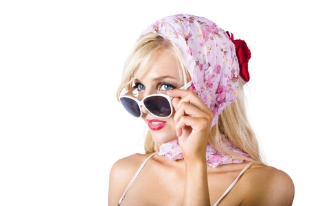 Classy young blond woman in pink headscarf and sunglasses on white background photo