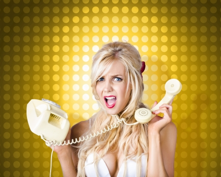 Image of a hysterical pinup girl tangled in a fifties phone cord knot. Retro communication tangle photo