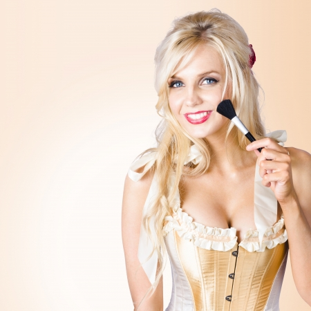 Young blonde beauty applying make up with cosmetics brush. Performing arts stage makeup concept photo
