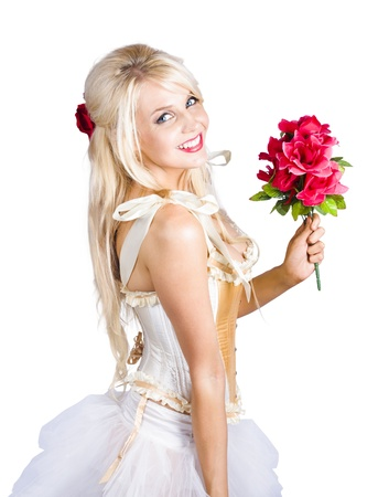 Beautiful blond woman in stylish dress with bouquet of red flowers on white background. photo