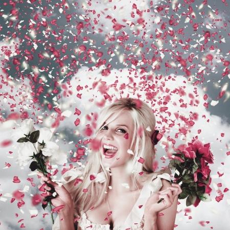 Delighted loving woman celebrating a wedding amongst falling flower confetti. Romantic celebration Stock Photo - 20097412