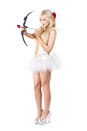 Blonde cupid in high heels shooting a red rose arrow isolated on white photo
