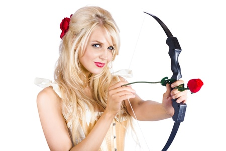 Beautiful young blond woman with cupid bow and red rose arrow, love concept on white background photo