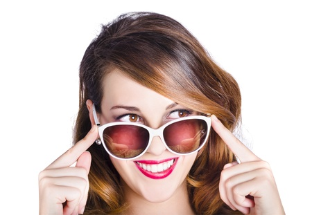 Portrait of happy young woman with long brunette hair in retro sunglasses on white studio background photo