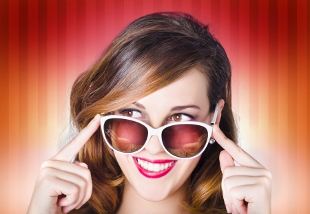 Face of a good-looking retro pinup girl wearing trendy sunglasses with hip fashion style photo