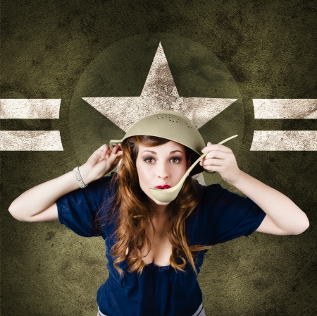 Funny vintage portrait of a cute american army pin-up girl cook using strainer for helmet. On military star background photo