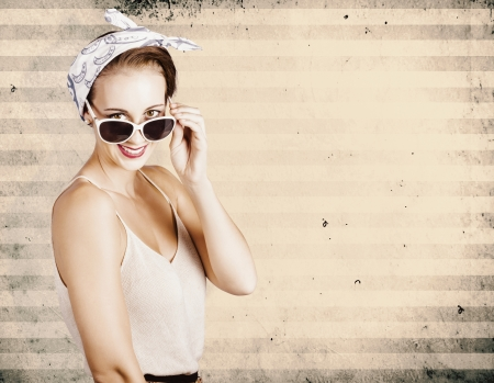 Smiling grunge fashion model wearing handkerchief and fashionable eyewear on old distressed copyspace photo