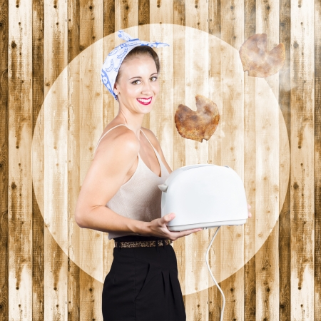 Female breakfast waiter holding toaster with heart-shape toast flying into the smoky air. Hearty breakfast concept photo