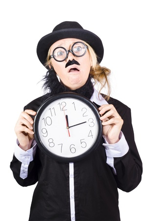 Woman disguised as man with hat and mustache holding large clock, business time shedule concept on white background. photo