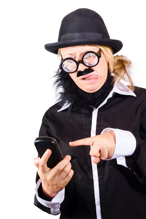 Weird woman in black bowler hat fake beard and mustache wide rimmed glasses sending text message with phone photo