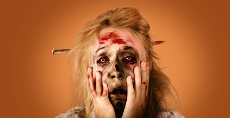 Halloween zombie with distressed look of fear and terror. Halloween nightmare concept photo