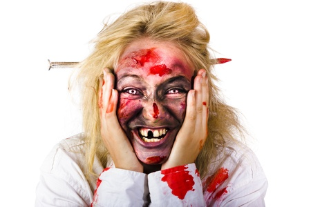 Portrait of crazy blood covered female zombie smiling with nail piercing through head on white background Stock Photo - 20035741