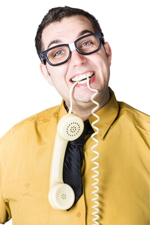 Cheerful nerd businessman with retro telephone hanging from mouth - word of mouth concept Stock Photo - 20035955