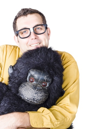 Smiling man in yellow shirt holding the head of a gorilla costume Stock Photo - 20059650