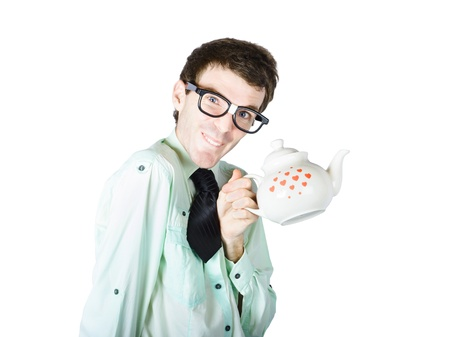 Young man in thick rimmed glasses holding white coffee pot decorated with red hearts photo