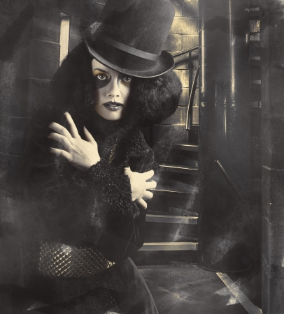 Amazing mysterious female magician posing in vintage fashion inside the grey halls of magic and illusion photo