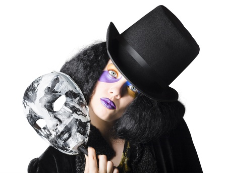 A woman in colorful make up holding a masquerade mask photo