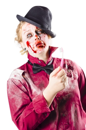 A rotten zombie woman with a bewildered look and a toothbrush photo