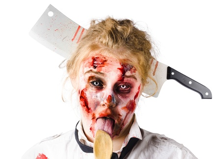 Beaten woman with meat cleaver in her head and licking a wooden spoon photo