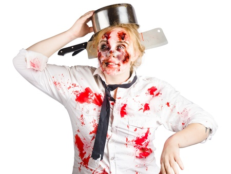 A zombie woman with a metal cooking pan on head.  photo