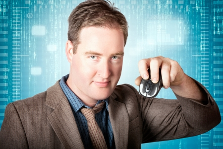Businessman holding wireless mouse when searching internet technology websites. Blue tech background photo