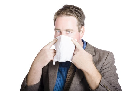 Health conscious businessman covering face with tissue to prevent the spread of airborne bacteria. Stock Photo - 20028277
