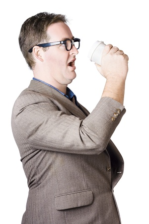 Isolated image of a running businessman consuming hot drink in hurry. Coffee rush photo
