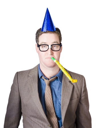 Isolated picture of a drunk male worker at yearly work party tooting horn in dorky business fashion photo