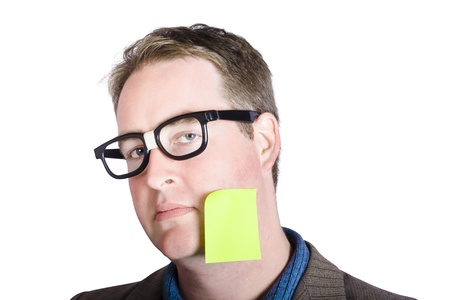 Male marketing manager with blank page memo stuck to his cheek Stock Photo - 19957346