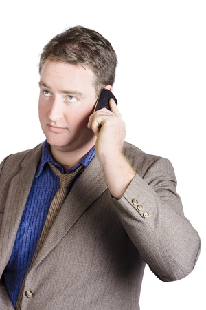 Isolated male office manager discussing business on smartphone conversation.  photo