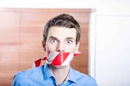 Businessman in silence with red warning tape. Red tape bureaucracy Stock Photo - 20027800