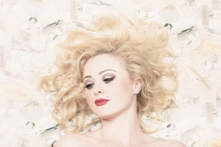 Pinup portrait of a beautiful sexy blond girl with classic makeup and short wavy blond hair on vintage design background Stock Photo - 20204874