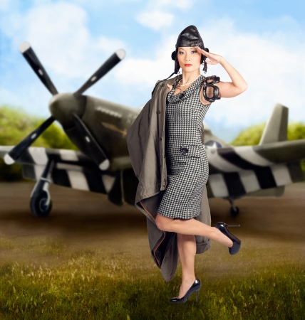 Artistic photo illustration of a beautiful asian pinup woman in 1940s military dress making a salute in front of an air force bomber plane illustration