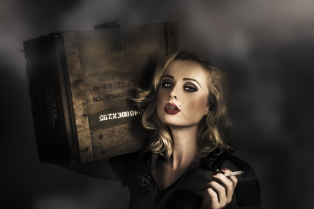 Retro military pinup girl in grunge army fashion holding ammo resupplies with smoking hot blond hairstyle and classic makeup. All's fair in love and war photo