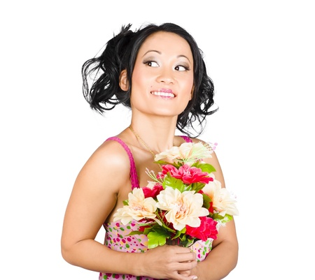 Isolated image of a beautiful Asian girl accepting a colourful bunch of flowers. Nature love photo