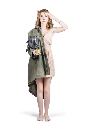 Attractive young Australian army pinup woman saluting with Military gasmask and RAF jacket. ANZAC honour and pride photo