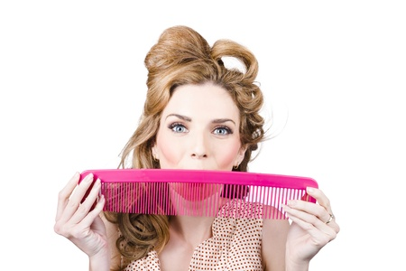 Funny photograph of a happy pinup woman smiling with hair comb. Retro hairstyle photo