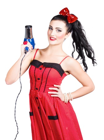 Young brunette lady shooting hair dryer with beautiful hair style on white background. Killer hair style photo