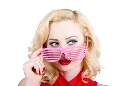 Blond pinup girl in stylish retro pink shades. Turning heads to fashion accessory copyspace photo
