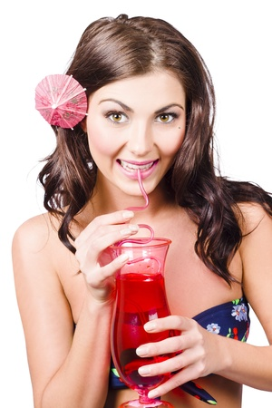 Smiling tropical girl drinking red cocktail drink during summer holidays. Sweet holiday treat photo