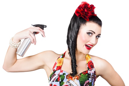 Cute 1980s brunette pinup woman with entwined hairstyle using hair product spray. Hair care photo