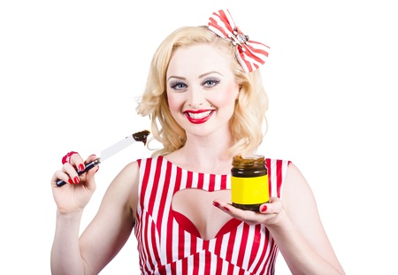 Cute retro Australian pinup woman from 1950 holding yeast extract sandwich spread and jar. Australia icon photo