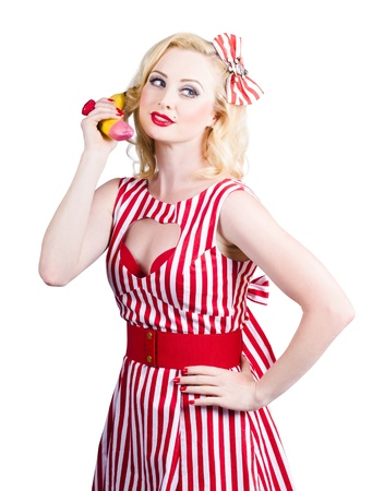Retro pin up woman placing organic food order on banana phone. Healthy eating communication photo