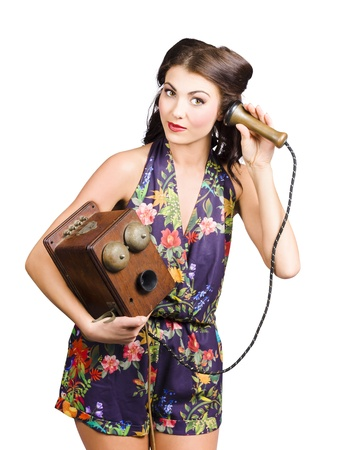 Old-fashioned retro receptionist listening on vintage bell telephone over white background. We hear you photo