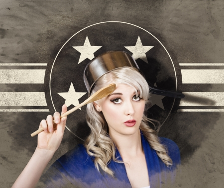 Funny grunge portrait of a beautiful retro pin up housewife wearing army cooking helmet when gesturing a military salute on stars and stripes background. Bangers and MASH – yes sir photo