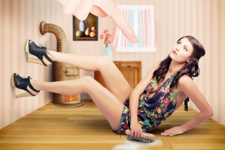 Young sexy slim pin up girl with tidy brunette hair style and classic make up scrubbing floor in retro fashion. Fashion choice for vintage women  photo
