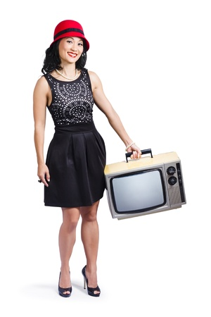 Smiling woman carrying a portable television photo
