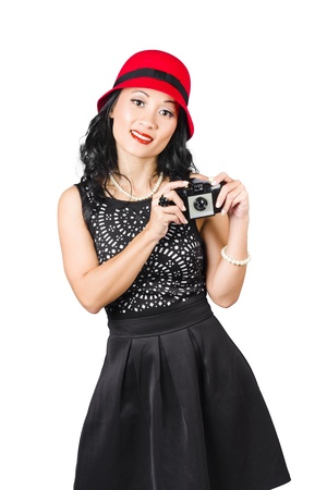 Isolated photograph of a pretty Asian woman with old camera taking photo photo